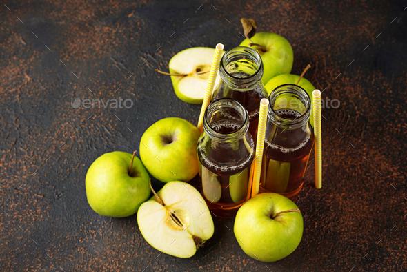 Bottles with fresh apple juice - Stock Photo - Images