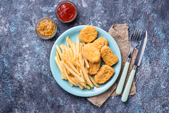 French fries and chicken nuggets - Stock Photo - Images