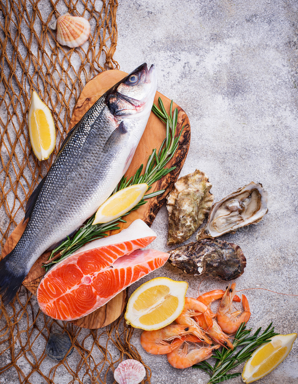 Seafood concept. Fish, shrimps and oysters. - Stock Photo - Images