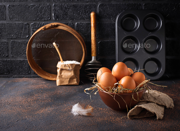 Fresh raw brown eggs in bowl - Stock Photo - Images