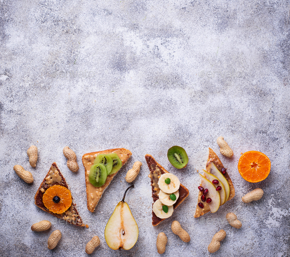 Healthy  sandwiches with peanut butter and fruits - Stock Photo - Images