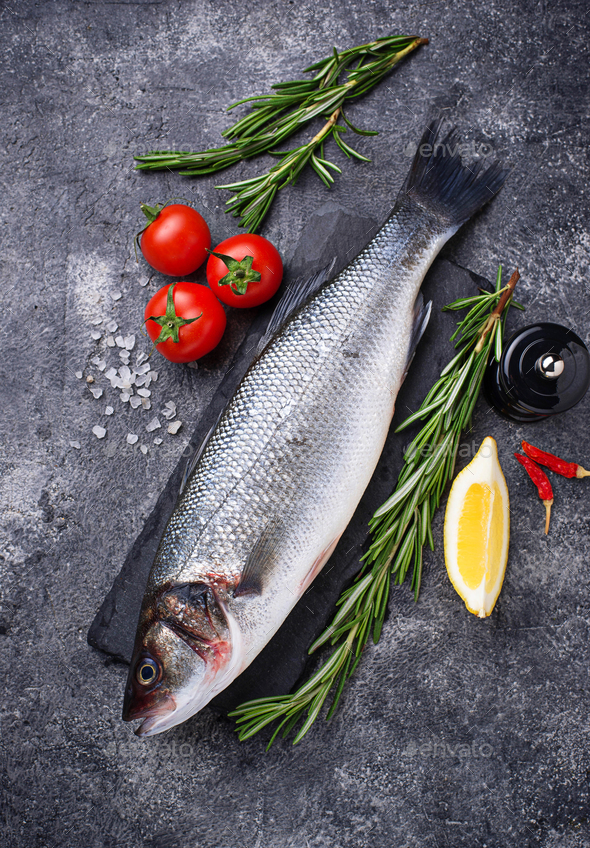 Raw fish seabass with condiments - Stock Photo - Images