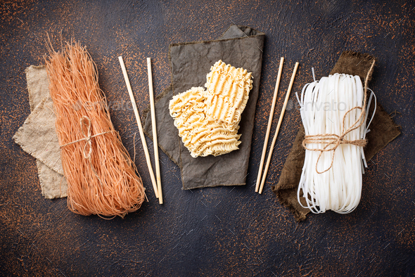 Different Asian rice noodles on rusty background - Stock Photo - Images