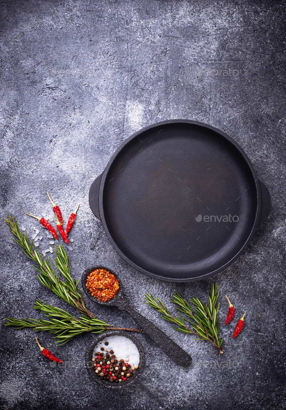 Cast iron frying pan with herbs and spices - Stock Photo - Images