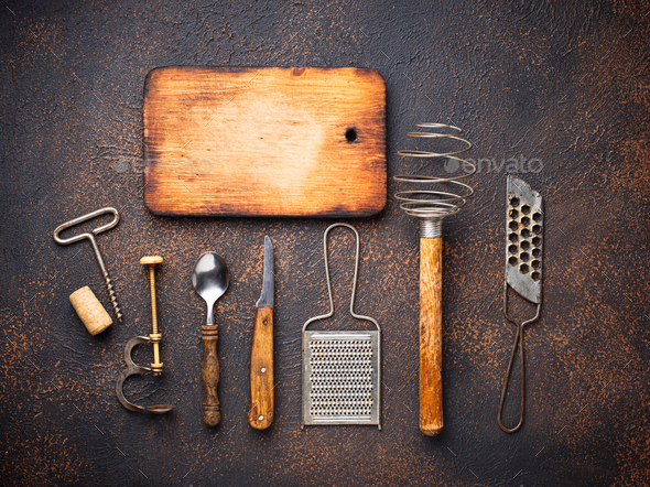 Old vintage kitchen utensils on rusty background - Stock Photo - Images