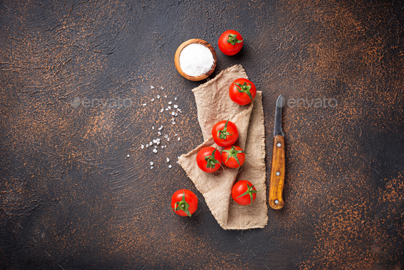 Fresh cherry tomatoes on rusty background - Stock Photo - Images