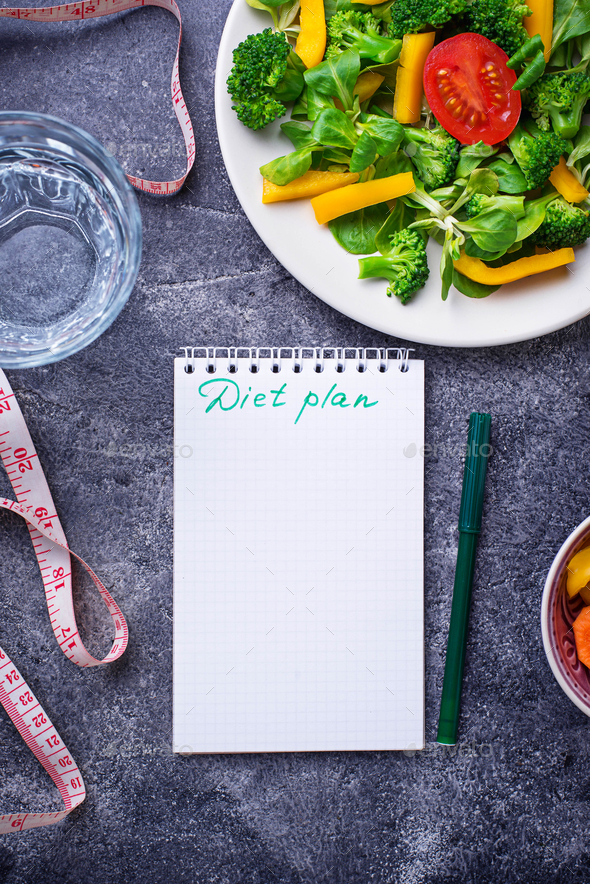 Healthy salad, clean water and measuring tape. - Stock Photo - Images