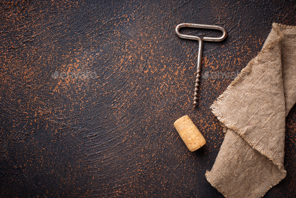 Old vintage corkscrew and wine cork - Stock Photo - Images