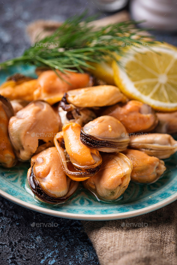 Marinated mussels with lemon and spices - Stock Photo - Images