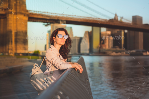 Young girl at the Brooklyn Bridge - Stock Photo - Images