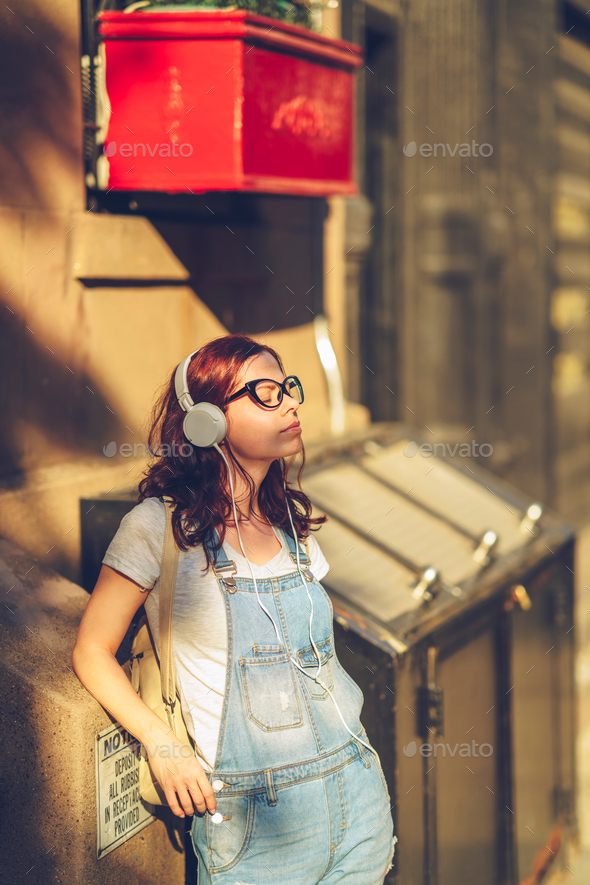 Young girl in headphones in New York City - Stock Photo - Images