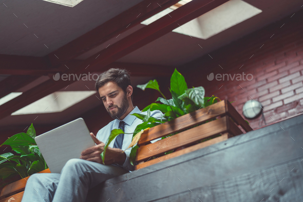 Young businessman in the loft - Stock Photo - Images