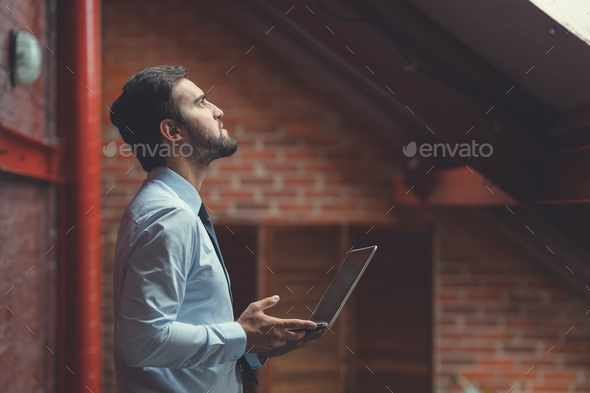 Attractive young man in the loft - Stock Photo - Images