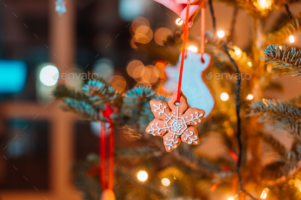 Christmas tree decorated with gingerbread cookies and garland - Stock Photo - Images