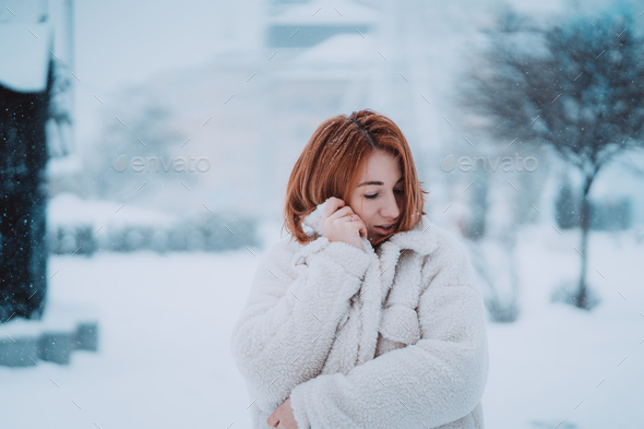 Woman outside on snowing cold winter day - Stock Photo - Images