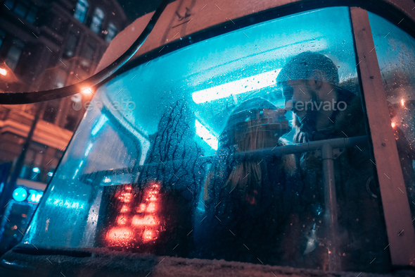 The guy and the girl kiss on the tram behind the misted glass - Stock Photo - Images