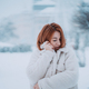 Woman outside on snowing cold winter day - PhotoDune Item for Sale