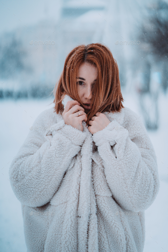 Portrait female model outside in first snow - Stock Photo - Images