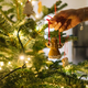 Female hand hangs angel gingerbread on the Christmas tree - PhotoDune Item for Sale