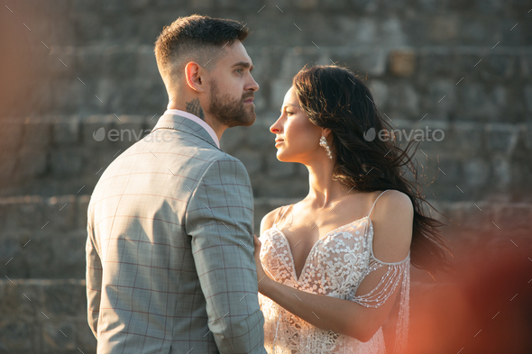 Caucasian romantic young couple celebrating their marriage in city - Stock Photo - Images