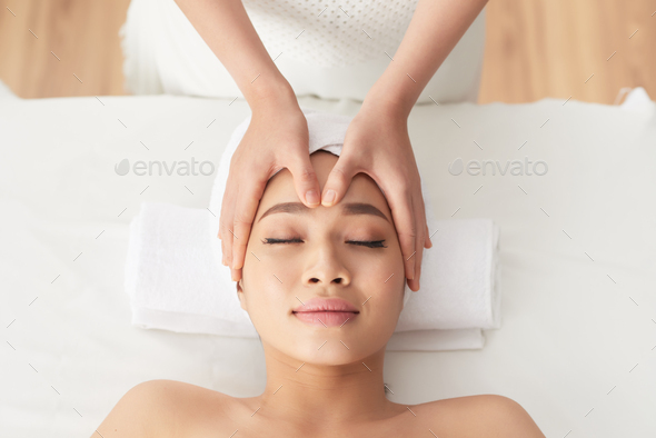 Rejuvenating face massage - Stock Photo - Images