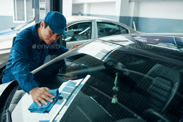Wiping windshield - Stock Photo - Images