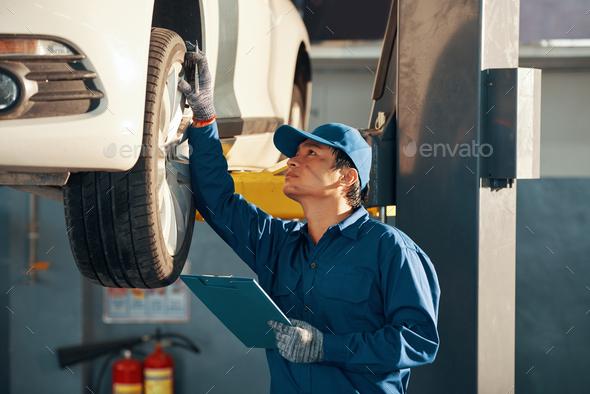 Mechanic checking car - Stock Photo - Images