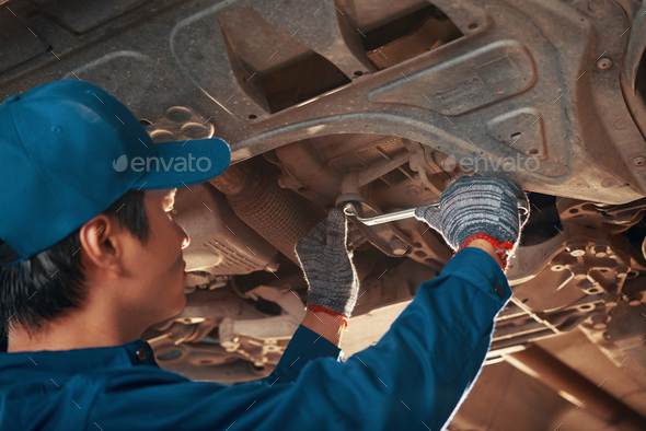 Mechanic tightening nut - Stock Photo - Images