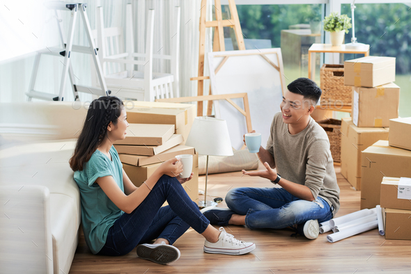 Young people discussing relocation - Stock Photo - Images