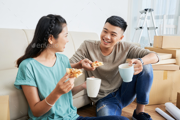 Couple in new apartment - Stock Photo - Images