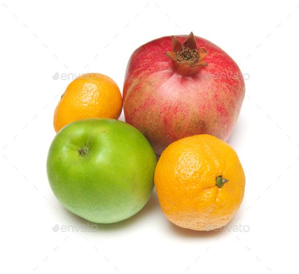 Pomegranade, apple, tangerine on white - Stock Photo - Images