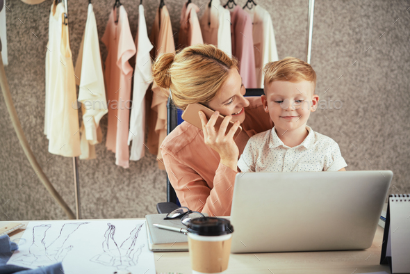 Pretty fashion designer and her son - Stock Photo - Images