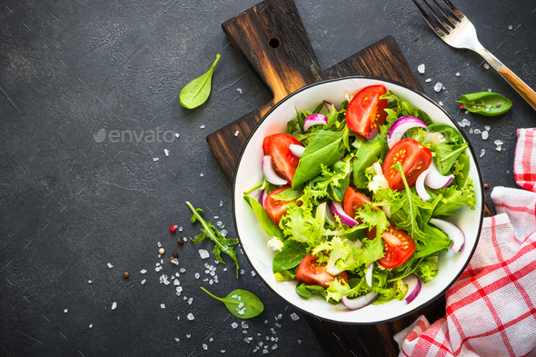 Green salad from leaves and tomatoes - Stock Photo - Images