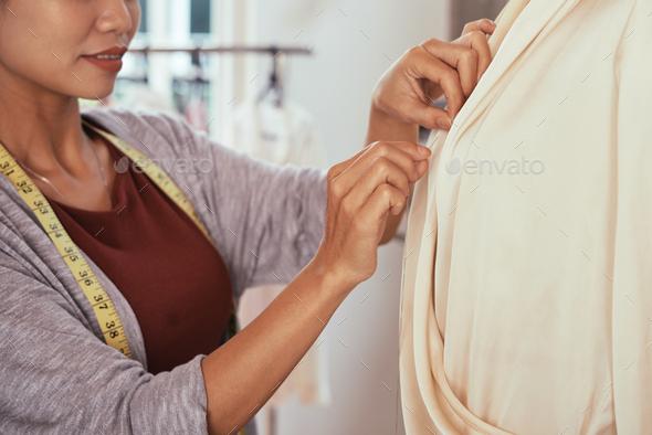 Crop fashion designer making blouse on dummy - Stock Photo - Images
