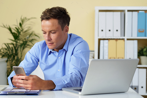 Businessman addicted to social media - Stock Photo - Images