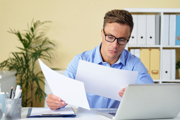 Business executive checking documents - Stock Photo - Images