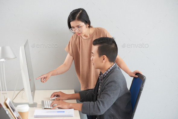 Helping coworker - Stock Photo - Images