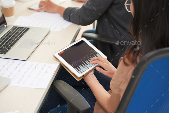 Testing synthesizer app - Stock Photo - Images