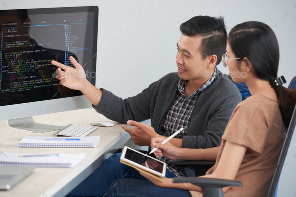 Developers discussig code - Stock Photo - Images