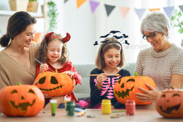 family celebrating Halloween - Stock Photo - Images
