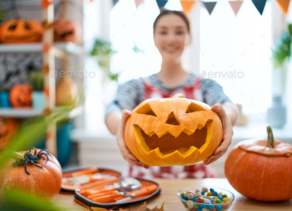 Woman is carving pumpkin - Stock Photo - Images