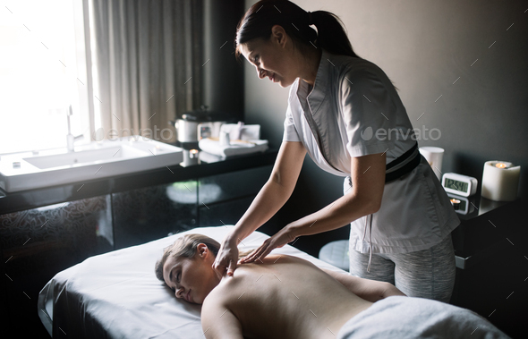 Massage, health, beauty and relaxation concept. Beautiful woman in spa salon - Stock Photo - Images