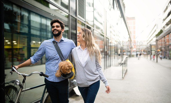 Couple in love with dog walking and smiling outdoor - Stock Photo - Images