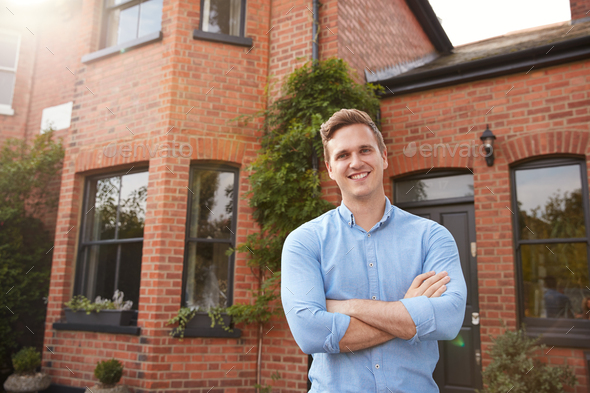 Portrait Of Excited Man Standing Outside New Home Holding Keys - Stock Photo - Images