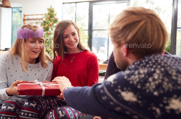 Gay Friends At Home Exchanging Gifts On Christmas Day Together - Stock Photo - Images