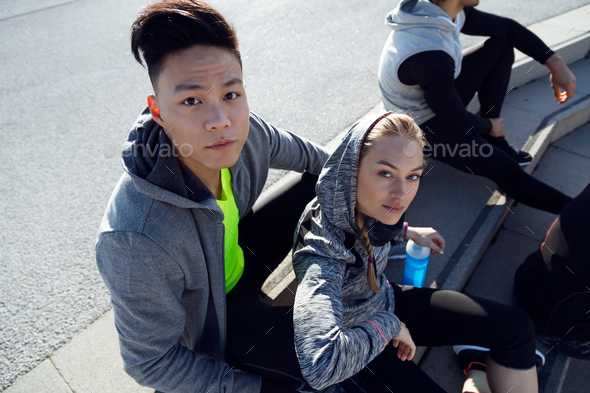 Fit and sporty young team relaxing after work out in the city. - Stock Photo - Images
