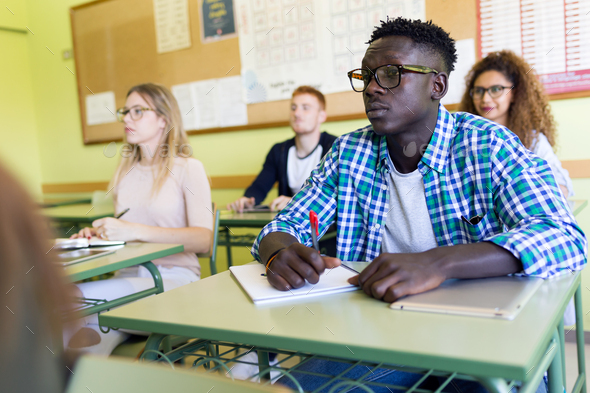 Group of friends studying in a university classroom. - Stock Photo - Images