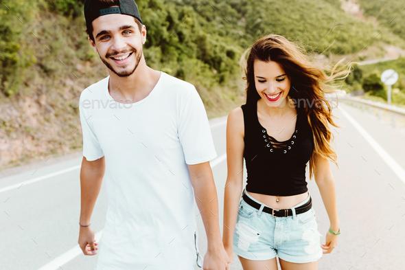 Beautiful young couple enjoying nature on mountain. - Stock Photo - Images