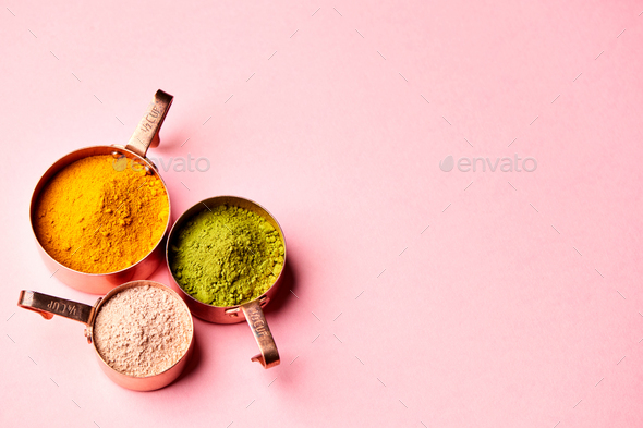 Overhead View Of Natural Beauty And Health Products In Measuring Cups On Pink Background - Stock Photo - Images