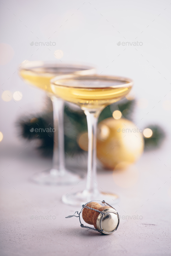 Two champagne glasses,cork and Christmas decorations, close up - Stock Photo - Images